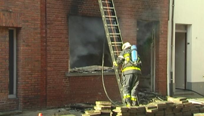 Gemeentearbeider redt vrouw uit brandende woning