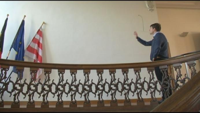 Loflied van Felix Timmermans op binnenmuur stadhuis
